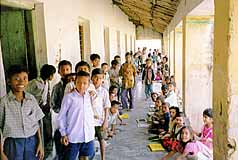 School children waiting for vaccinations from IHO