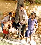 Kids at an IHO-installed water pump