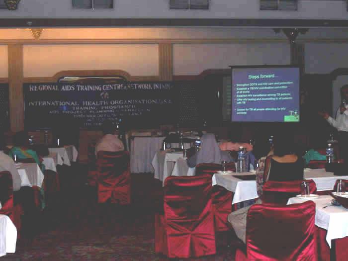 Participants watch presentation on HIV Program Management