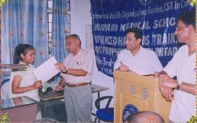 Dr. B.B. Verma , Regional Director IHO, with Dr. Diwakar Tejaswi and Mr. B.K. Sinha distributing a certificate to a Paramedical student during the Level-II training program at the IHO training hall in Patna